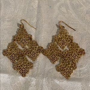 Goldtone triangular statement earrings